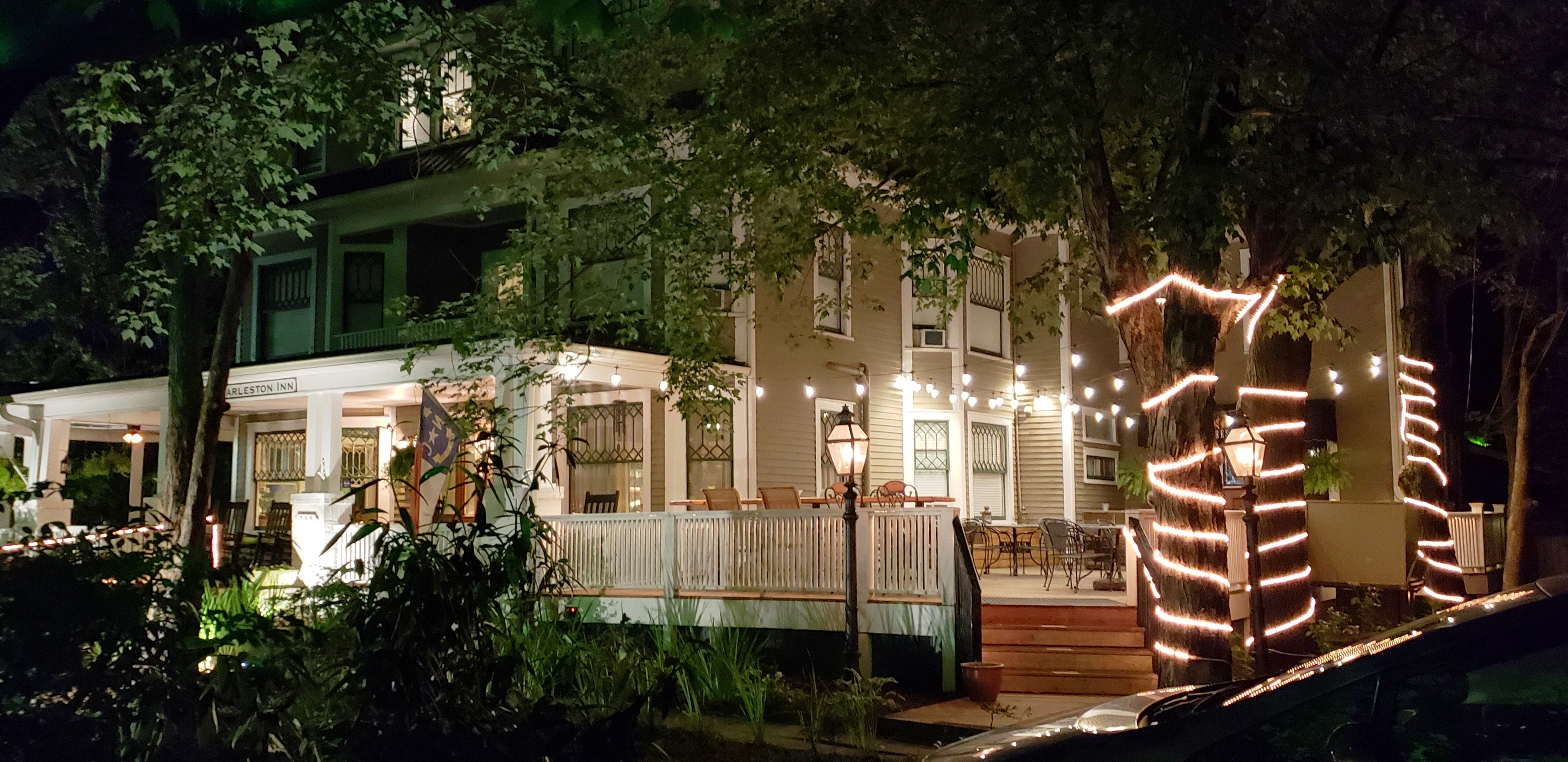 The Charleston Inn's Awesome Front Porches at Night!